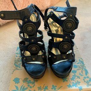 Black wedge heels with bronze detailing